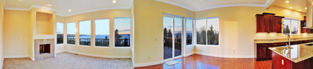 Panoramic view of empty house interior and beautiful sunset view  photo