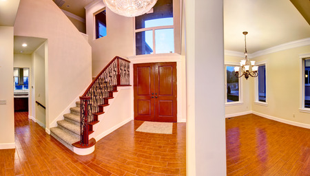 Entrance hallway with high ceiling and hardwood floor  Panoramic picture photo
