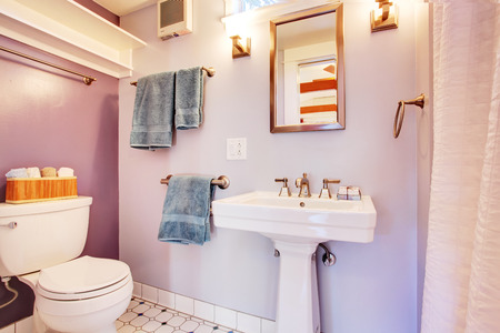 Lavender walls bathroom with white appliances  Detached guest house vacation rental cottage Stock Photo - 28041800