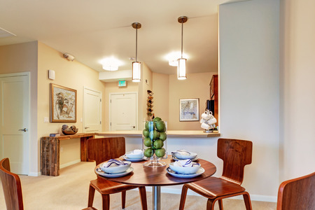 open floor plan: Modern apartment with open floor plan  View of served dining table in dining area
