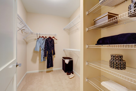 Light tones walk-in closet with shelves photo