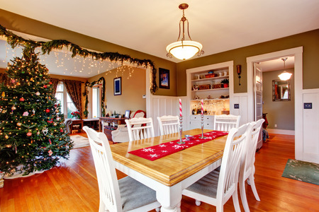 living room sofa: Beatifully decorated dining and living room on Christmas eve Stock Photo