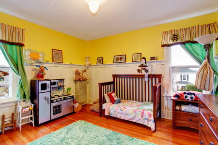 clean carpet: Bright yellow room for kids with toys