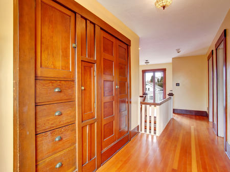 Upstairs hallway with hardwood floor and built-in cabinet photo