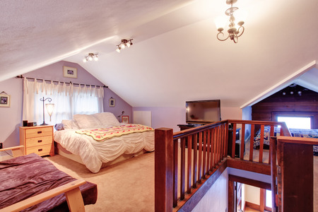 Bedroom with vaulted ceiling and carpet floor  photo