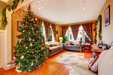 Cozy house interior on Christmas eve  View of living room with Christmas tree photo