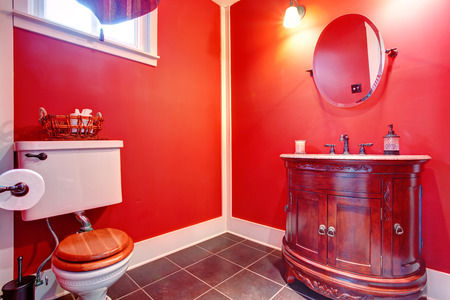 Bright red bathroom with antique washbasin cabinet Stock Photo - 28130380