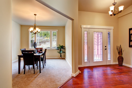 House interior  View of entrance hallway and dining area with served table photo