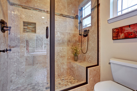 View of glass door shower with tile wall and floor  Stock Photo