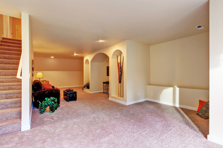 niche: Entertainment room with niche in the wall, couch and ottoman