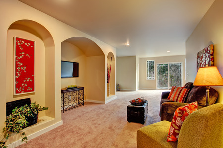 niche: Entertainment room with niche in the wall, couch and ottoman  Stock Photo