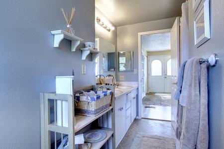 Bathroom with wooden shelf  View of entance hallway through the open door Stock Photo - 28250176