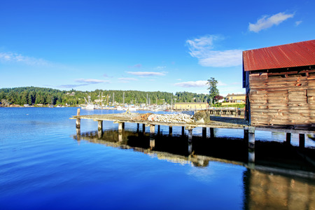 puget sound: View of the bay with dock and old wooden building in Tacoma, Washington state