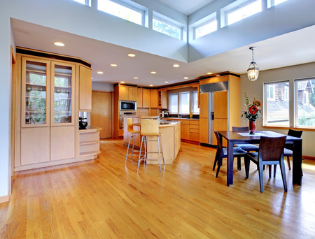 open plan: Large luxury modern wood kitchen with granite counter tops and yellow hardwood floor