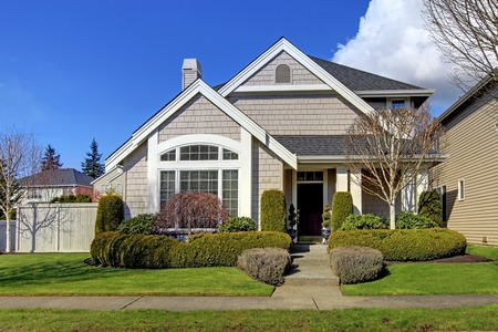 Classic new beige American house exterior in the spring  Stock Photo