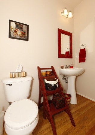 Small bathroom with sink and toilet and hardwood floor  photo