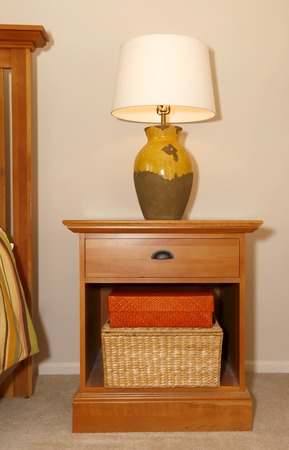 nightstand: Wood furniture nightstand with lamp and bed