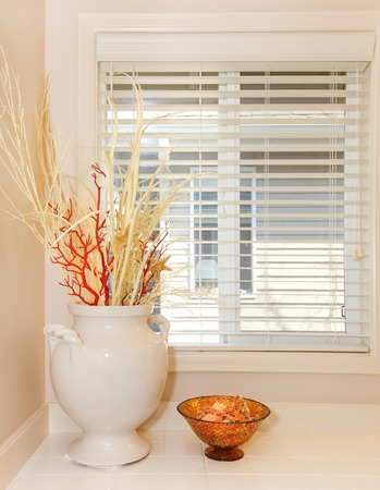 Window with white vase and tiles - bathroom details  Stock Photo