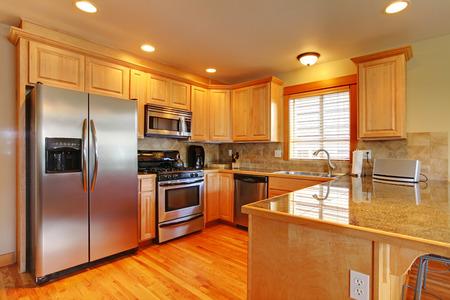 designer chair: Kitchen with hardwood floor and granite
