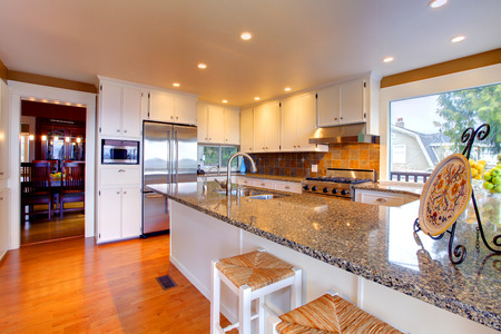 designer chair: Shiny kitchen room with island and stools