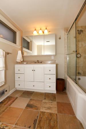 double sink: Bathroom interior  View of vanity and glass door shower