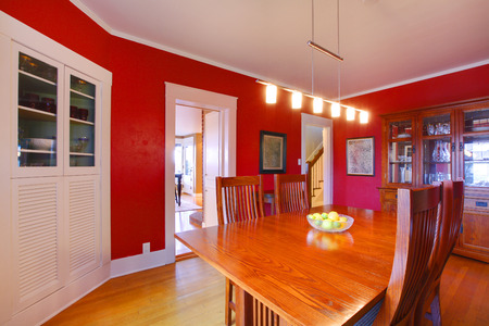 Dining room with red walls photo