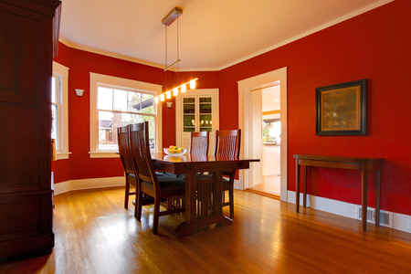 wood molding: Dining room with red walls