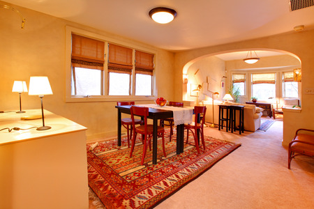Spacious dining room with table set and view of living room