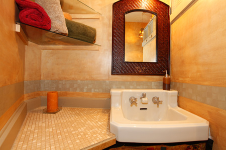 Golden bathroom with white sink photo