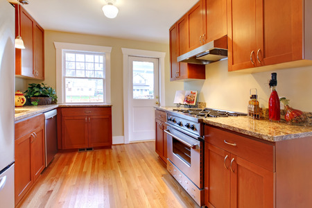 Beautiful new kitchen with stainless steal and cherry wood