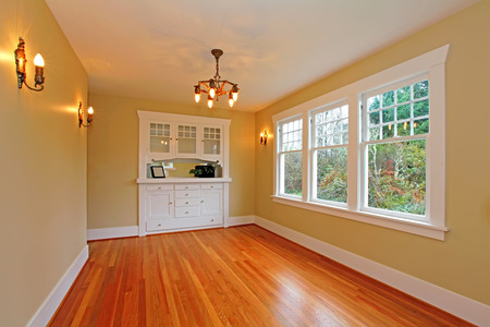 wood molding: Elegant cute  empty living room in a old historical house in Tacoma, WA