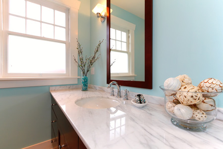Beautiful blue remodeled bathroom with white marble
