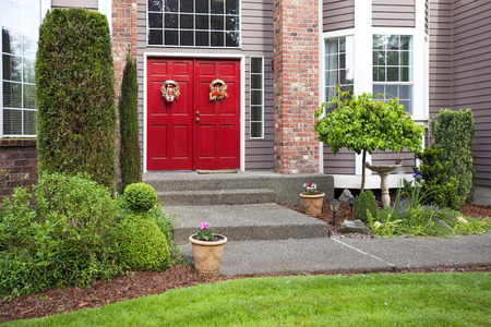 View of house entrance with brick columns and red double doors Stock Photo - 28620523