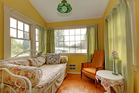 small room: Small Living room with sleeping sofa and reading corner in yellow and green.