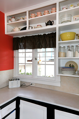 old items: Old simple white kitchen with brick wall. Stock Photo