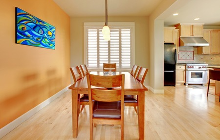 simple meal: Nice dining room with hardwood floor and kitchen. Stock Photo