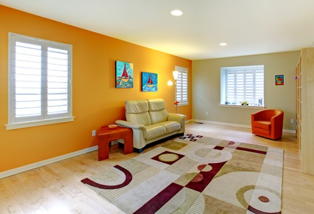 Living room with play area for kids in orange. photo