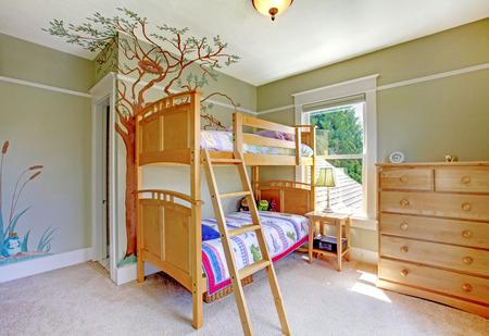 bedroom furniture: Baby girl bedroom with double bulk bed.
