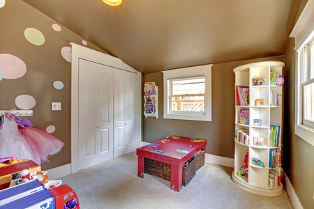Brown play room kids girl interior with toys. Stock Photo
