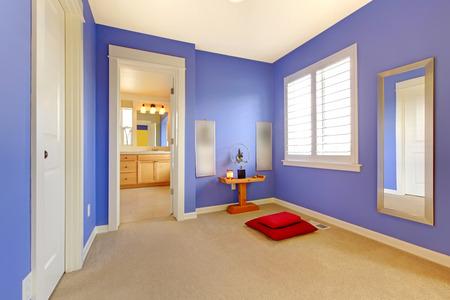 meditaion: Puple home meditation area with window and bathroom door.