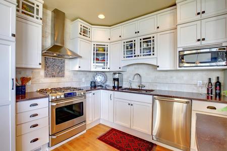 appliances: White new luxury kitchen with modern new appliances. Stock Photo