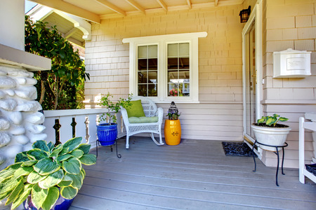 front view: Welcoming white cozy porch with furniture. Stock Photo