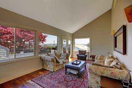 Living room with many windows, rug and two sofas. photo