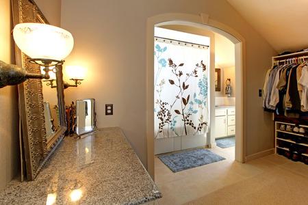 closet door: Large closet  room with door to bathroom with shower  Stock Photo
