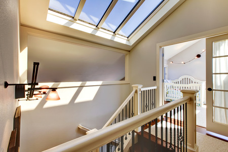 skylights: Staircase with skylight and baby room in a bright hallway
