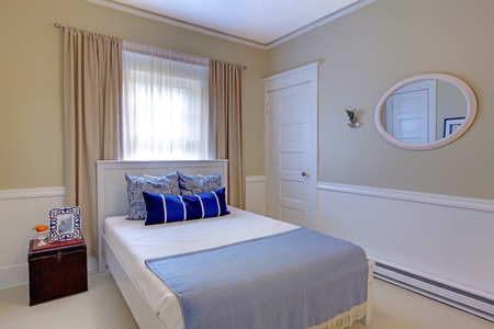 Furnished bedroom with open door to walkout deck  View of queen size bed,  antique wardrobe and dresser photo