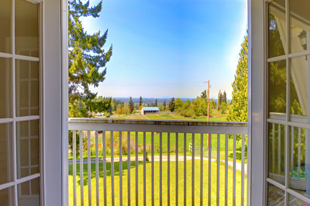 french doors: Beautiful nature view from open door to balcony  Countryside house during summer