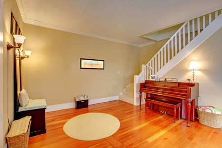 Hallway and entrance with staircase with beautiful hardwood floor. photo