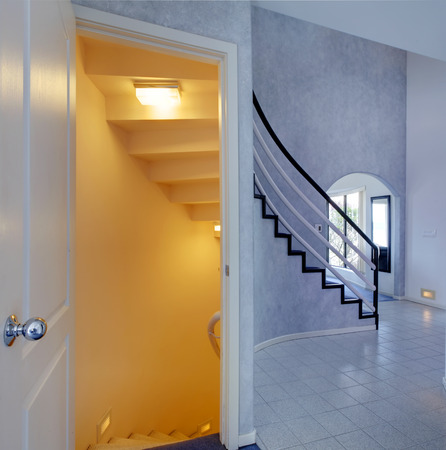 Modern foyer. View of staircase to basement photo