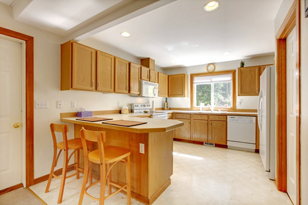 Simple kitchen room with window. Room has white appliances, storage combination and stools Stock Photo - 29001774